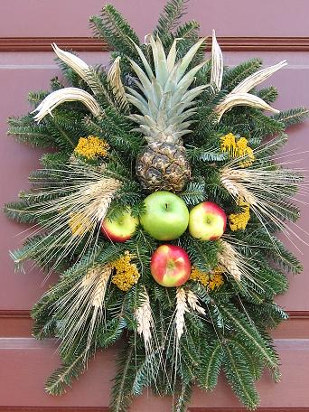 Pineapple, apples, okra, dried flowers and wheat