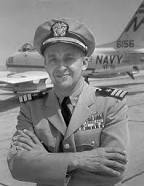 """Commander Alexander Vraciu in front of an FJ-3 """"Fury"""" like the one in which he won top honors at the 1957 Naval Air Weapons Meet in El Centra, California. - U.S. Navy Photo"""